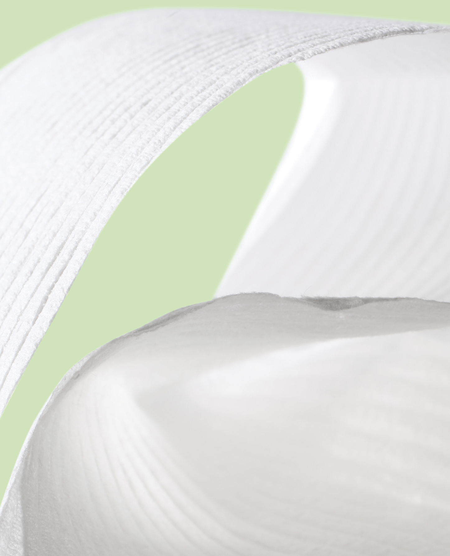 A close-up of a roll of toilet paper.