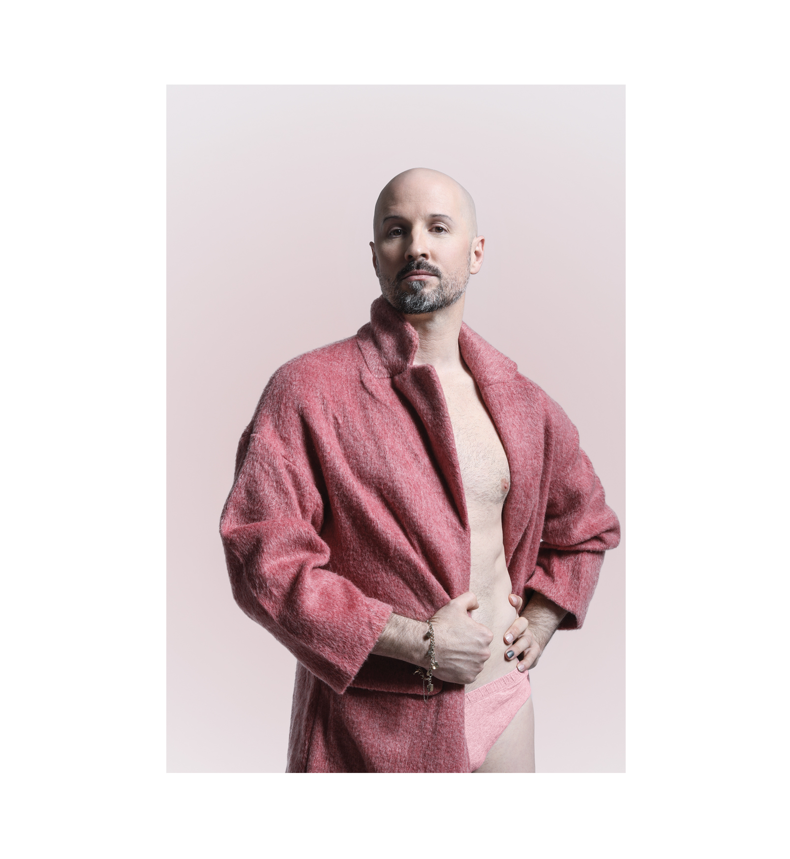 Robert Curran in a fuzzy pink jacket.