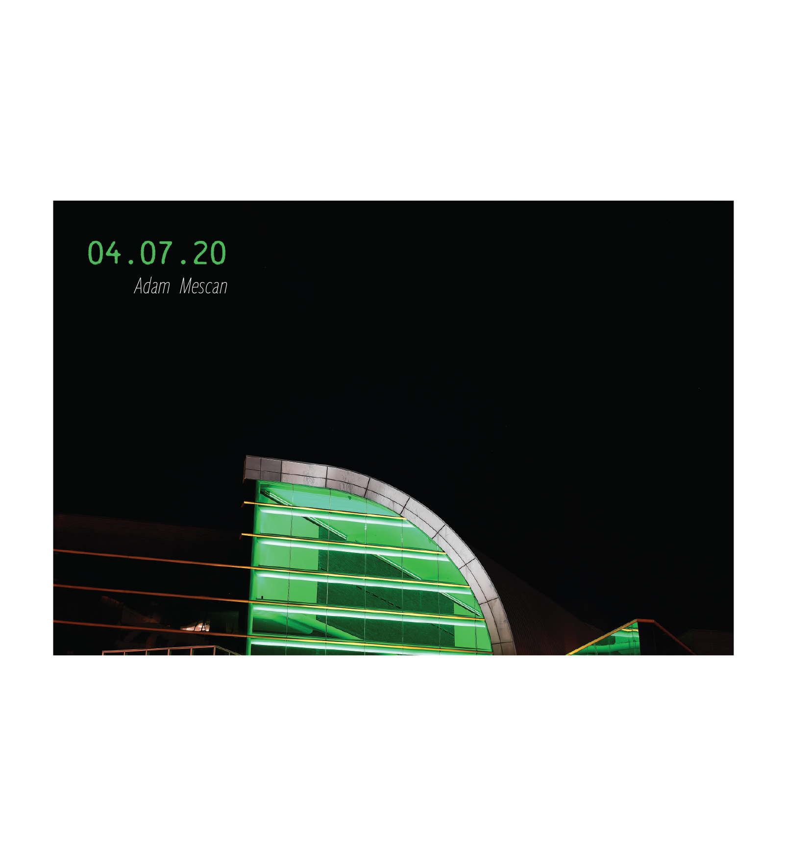 The top of the Kentucky Center, lit in green. 04.07.2020, by Adam Mescan