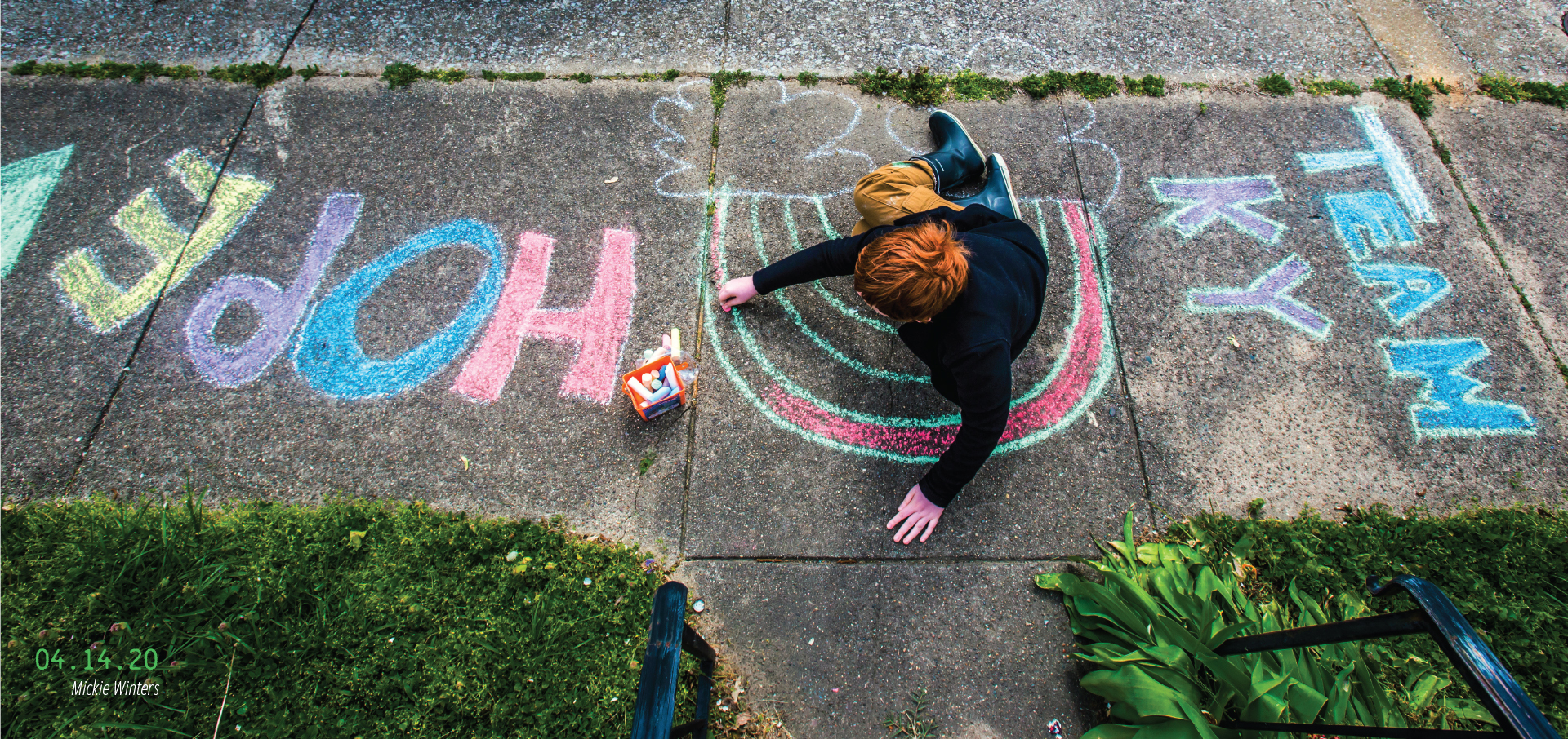 A kid drawing with sidewalk chalk. 04.14.2020, by Mickie Winters