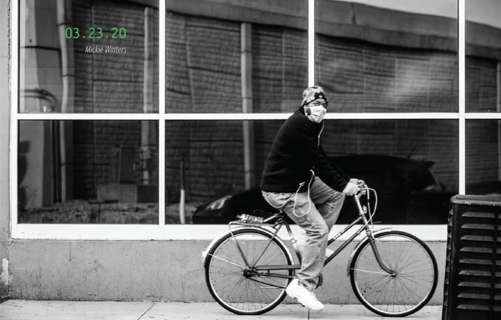 A bicyclist wearing a mask. 03.23.20, by Mickie Winters